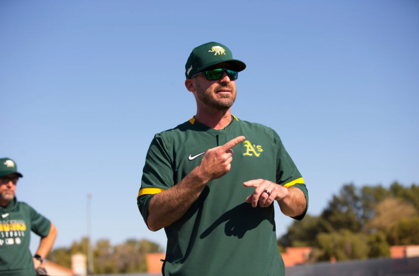 MESA, AZ - February 17: Bench Coach Ryan Christenson #29 of the Oakland Athletics goes over signs during a workout at Hohokam Stadium on February 17, 2020 in Mesa, Arizona. (Photo by Michael Zagaris/Oakland Athletics/Getty Images)