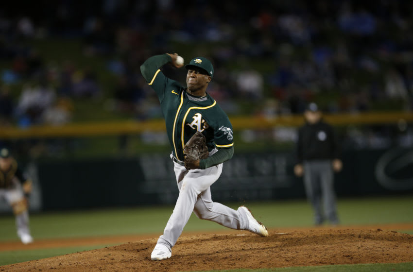 MESA, AZ - February 22: Miguel Romero #65 of the Oakland Athletics pitches during the game against the Chicago Cubs at Sloan Park on February 22, 2020 in Mesa, Arizona. (Photo by Michael Zagaris/Oakland Athletics/Getty Images)