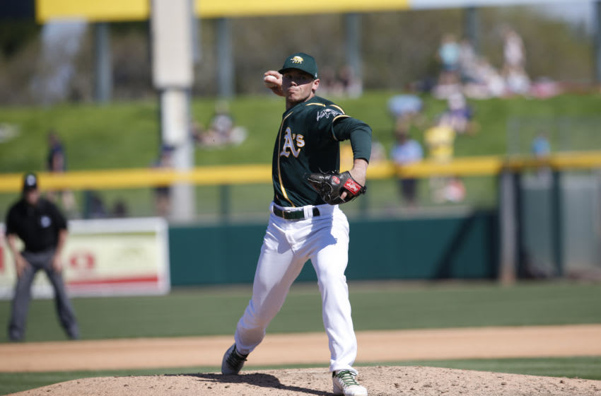 MESA, AZ - February 24: Daulton Jefferies #46 of the Oakland Athletics pitches during the game against the Milwaukee Brewers at Hohokam Stadium on February 24, 2020 in Mesa, Arizona. (Photo by Michael Zagaris/Oakland Athletics/Getty Images)