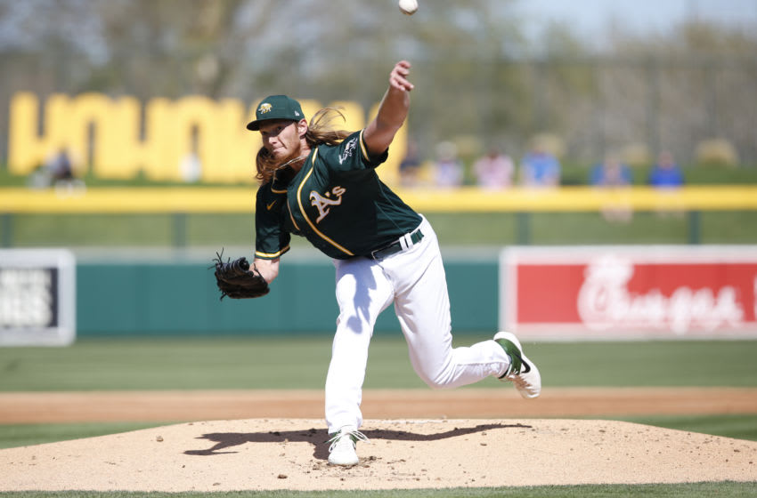 MESA, AZ - February 27: A.J. Puk #31 of the Oakland Athletics pitches during the game against the Colorado Rookies at Hohokam Stadium on February 27, 2020 in Mesa, Arizona. (Photo by Michael Zagaris/Oakland Athletics/Getty Images)