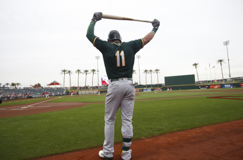 GOODYEAR, AZ - February 28: Dustin Fowler #11 of the Oakland Athletics stands in the on-deck circle prior to the game against the Cincinnati Reds at Goodyear Ballpark on February 28, 2020 in Goodyear, Arizona. (Photo by Michael Zagaris/Oakland Athletics/Getty Images)