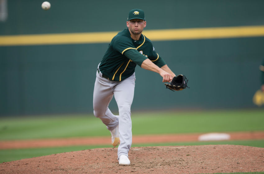 GOODYEAR, AZ - February 28: James Kaprielian #56 of the Oakland Athletics pitches during the game against the Cincinnati Reds at Goodyear Ballpark on February 28, 2020 in Goodyear, Arizona. (Photo by Michael Zagaris/Oakland Athletics/Getty Images)