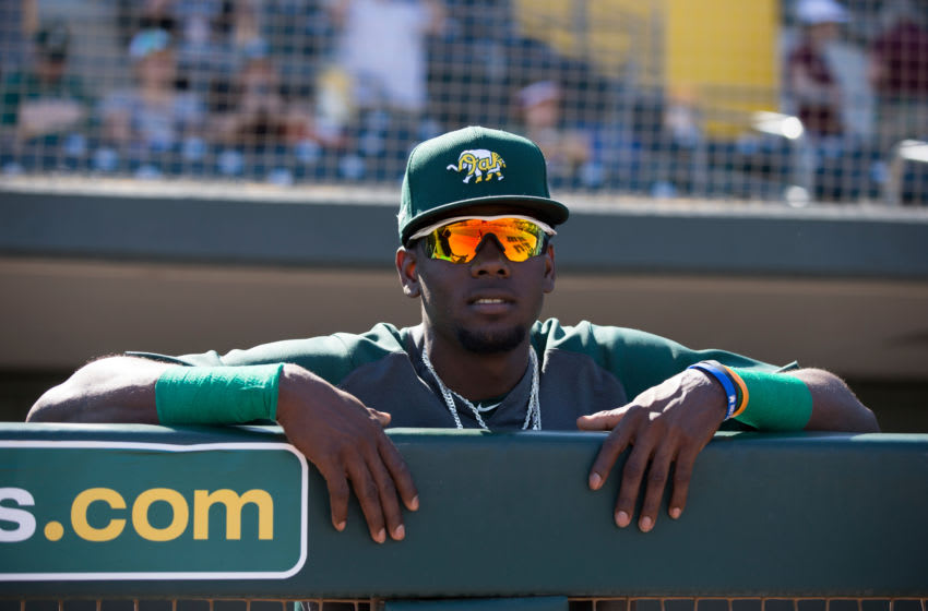 MESA, AZ - February 29: Robert Puason of the Oakland Athletics stands in the dugout prior to the game against the Cleveland Indians at Hohokam Stadium on February 29, 2020 in Mesa, Arizona. (Photo by Michael Zagaris/Oakland Athletics/Getty Images)