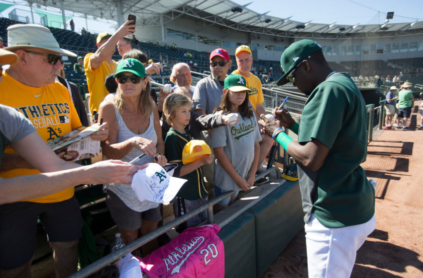 MESA, AZ - February 29: Robert Puason of the Oakland Athletics signs autographs prior to the game against the Cleveland Indians at Hohokam Stadium on February 29, 2020 in Mesa, Arizona. (Photo by Michael Zagaris/Oakland Athletics/Getty Images)