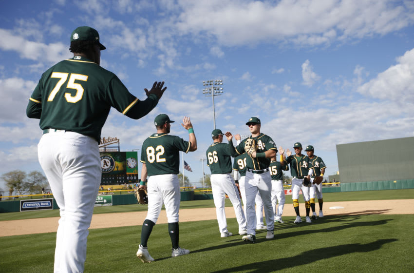 MESA, AZ - February 29: The Oakland Athletics celebrate on the field following the game against the Cleveland Indians at Hohokam Stadium on February 29, 2020 in Mesa, Arizona. (Photo by Michael Zagaris/Oakland Athletics/Getty Images)
