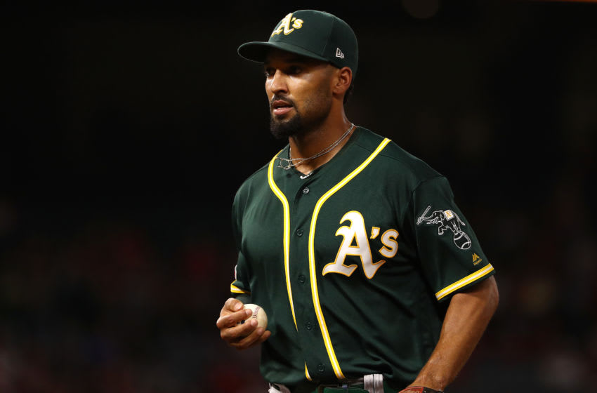 ANAHEIM, CALIFORNIA - SEPTEMBER 24: Marcus Semien #10 of the Oakland Athletics jogs back to the dugout after the third inning of the MLB game against the Los Angeles Angels at Angel Stadium of Anaheim on September 24, 2019 in Anaheim, California. The Angels defeated the Athletics 3-2. (Photo by Victor Decolongon/Getty Images)