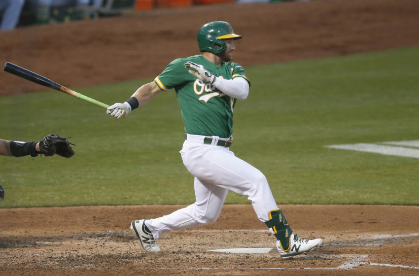 OAKLAND, CALIFORNIA - JULY 28: Robbie Grossman #8 of the Oakland Athletics hits a single in the bottom of the fourth inning against the Colorado Rockies at Oakland-Alameda County Coliseum on July 28, 2020 in Oakland, California. (Photo by Lachlan Cunningham/Getty Images)