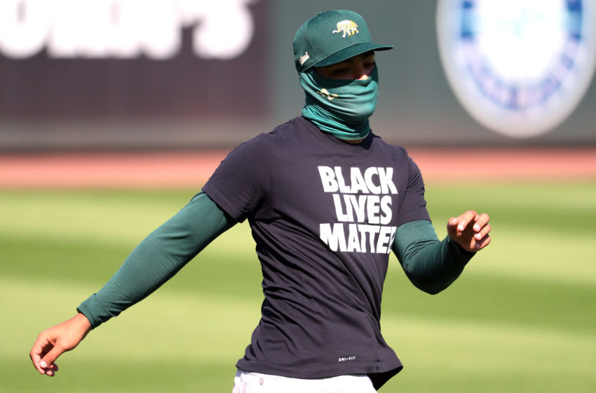 SEATTLE, WASHINGTON - JULY 31: Jesus Luzardo #44 of the Oakland Athletics warms up wearing a Black Lives Matter T-Shirt prior to their Opening Day game against the Seattle Mariners at T-Mobile Park on July 31, 2020 in Seattle, Washington. (Photo by Abbie Parr/Getty Images)