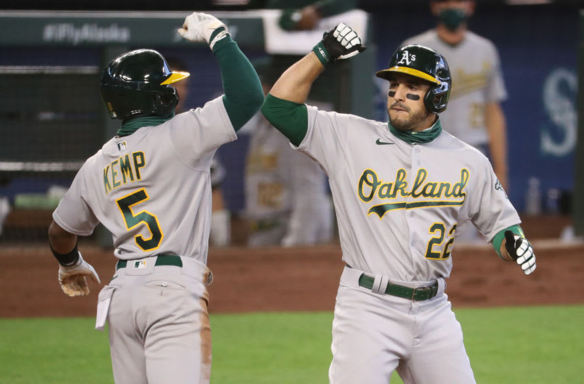 SEATTLE, WASHINGTON - AUGUST 02: Ramon Laureano #22 celebrates with Tony Kemp #5 of the Oakland Athletics after hitting a three run home run in the fifth inning against the Seattle Mariners during their game at T-Mobile Park on August 02, 2020 in Seattle, Washington. (Photo by Abbie Parr/Getty Images)