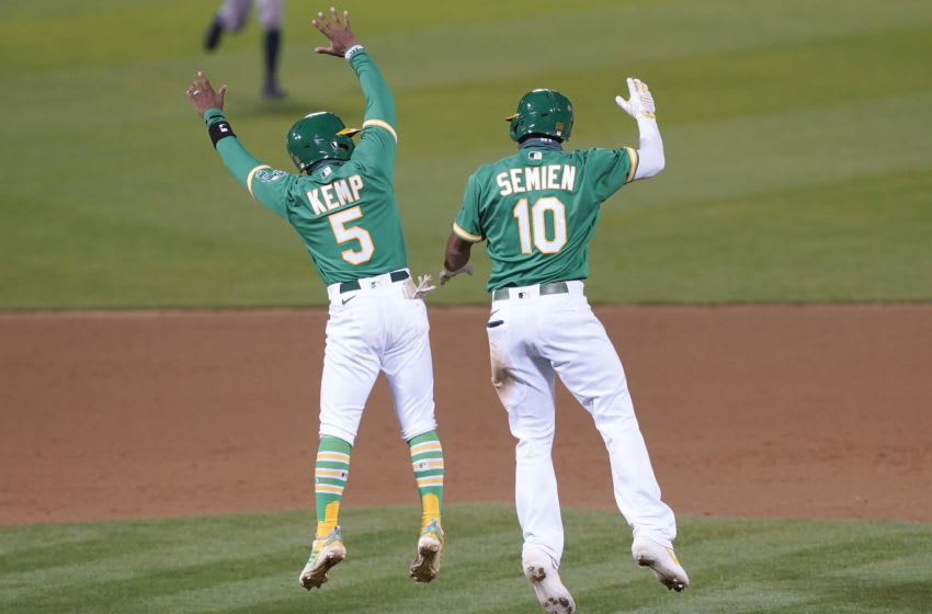 OAKLAND, CALIFORNIA - AUGUST 07: Marcus Semien #10 and Tony Kemp #5 of the Oakland Athletics celebrates after Semien hit a walk-off RBI single to defeat the Houston Astros 3-2 in the bottom of the 13th inning at RingCentral Coliseum on August 07, 2020 in Oakland, California. (Photo by Thearon W. Henderson/Getty Images)