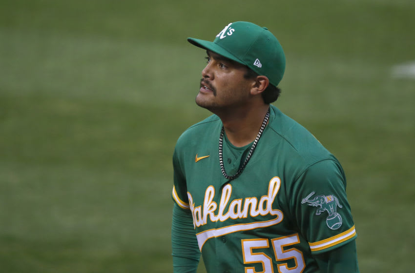 OAKLAND, CALIFORNIA - AUGUST 05: Starting pitcher Sean Manaea #55 of the Oakland Athletics leaves the game in the top of the fourth inning against the Texas Rangers at Oakland-Alameda County Coliseum on August 05, 2020 in Oakland, California. (Photo by Lachlan Cunningham/Getty Images)