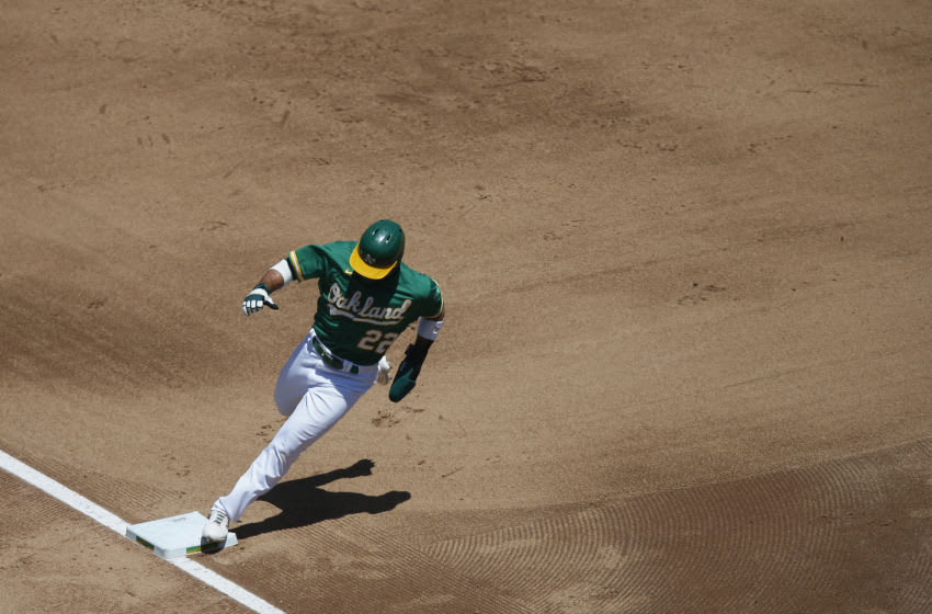 OAKLAND, CALIFORNIA - AUGUST 06: Ramon Laureano #22 of the Oakland Athletics rounds third base on the way to score on a single hit by Mark Canha #20 in the bottom of the fourth inning against the Texas Rangers at Oakland-Alameda County Coliseum on August 06, 2020 in Oakland, California. (Photo by Lachlan Cunningham/Getty Images)