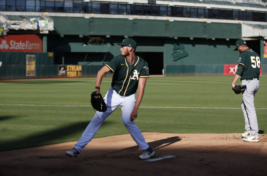 OAKLAND, CA - JULY 18: A.J. Puk #31 of the Oakland Athletics throws in the bullpen during summer workouts at RingCentral Coliseum on July 18, 2020 in Oakland, California. (Photo by Michael Zagaris/Oakland Athletics/Getty Images)