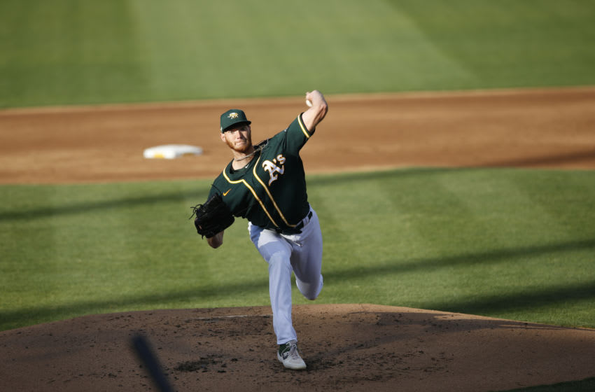 OAKLAND, CA - JULY 18: A.J. Puk #31 of the Oakland Athletics pitches during summer workouts at RingCentral Coliseum on July 18, 2020 in Oakland, California. (Photo by Michael Zagaris/Oakland Athletics/Getty Images)
