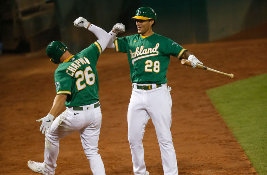 OAKLAND, CA - AUGUST 20: Matt Chapman #26 of the Oakland Athletics celebrates with Matt Olson #28 a home run during the game against the Arizona Diamondbacks at RingCentral Coliseum on August 20, 2020 in Oakland, California. The Athletics defeated the Diamondbacks 5-1. (Photo by Michael Zagaris/Oakland Athletics/Getty Images)