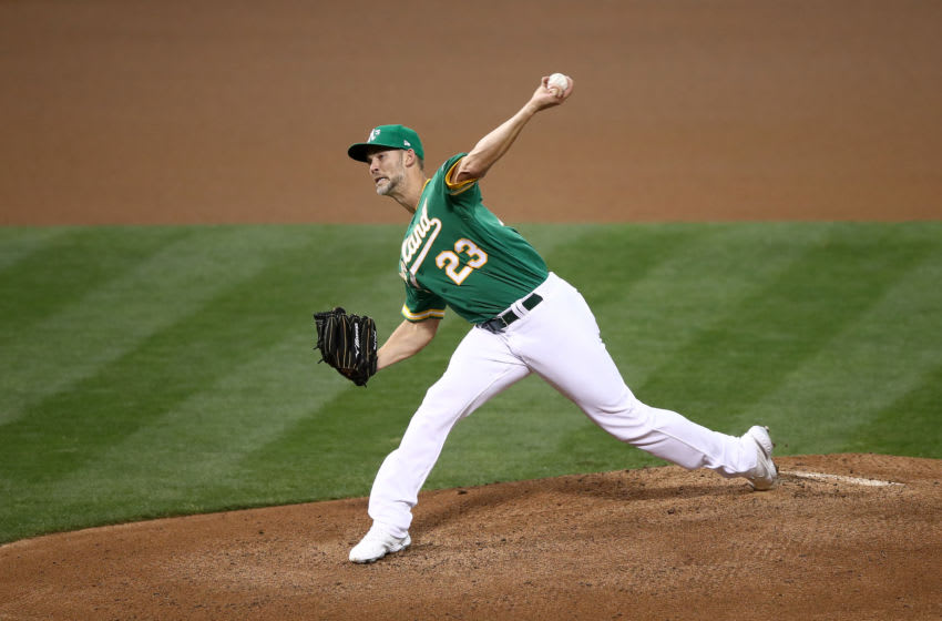 OAKLAND, CALIFORNIA - SEPTEMBER 08: Mike Minor #23 of the Oakland Athletics pitches against the Houston Astros in the first inning of the second game of their double header at RingCentral Coliseum on September 08, 2020 in Oakland, California. (Photo by Ezra Shaw/Getty Images)