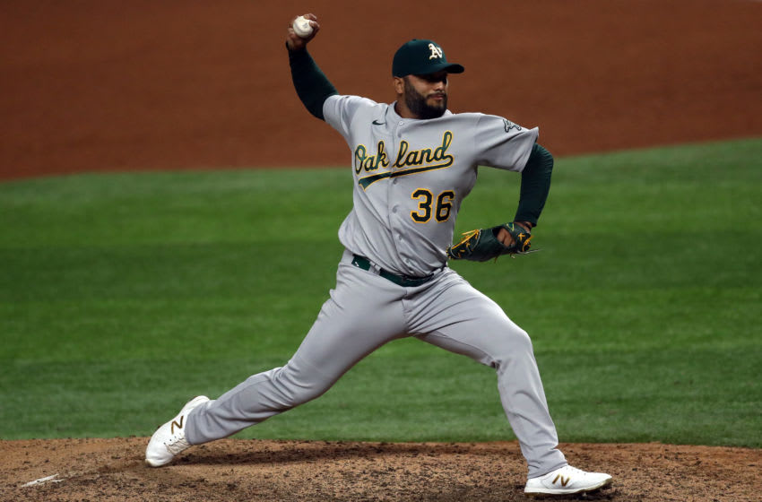 ARLINGTON, TEXAS - SEPTEMBER 12: Yusmeiro Petit #36 of the Oakland Athletics throws against the Texas Rangers in the seventh inning at Globe Life Field on September 12, 2020 in Arlington, Texas. (Photo by Ronald Martinez/Getty Images)