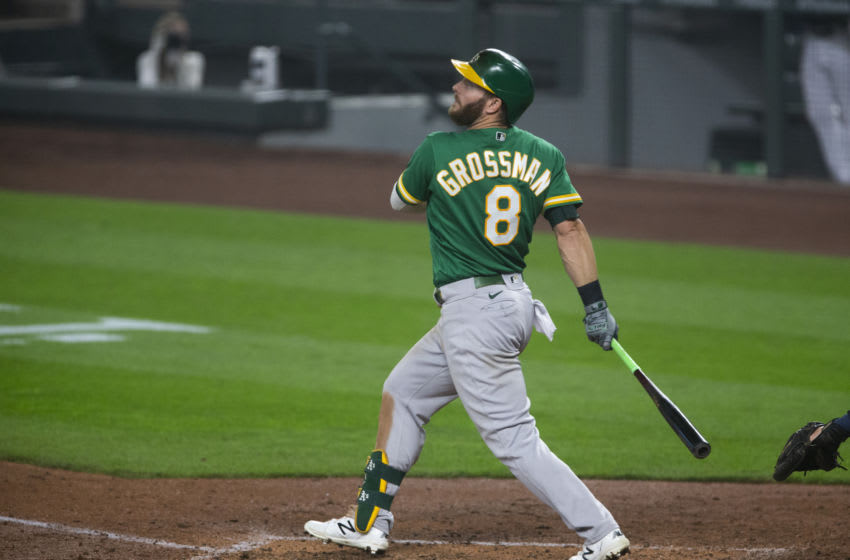 SEATTLE, WA - SEPTEMBER 14: Robbie Grossman #8 of the Oakland Athletics follows through on an RBI single during the third inning against the Seattle Mariners in the second game of a doubleheader at T-Mobile Park on September 14, 2020 in Seattle, Washington. The Oakland Athletics beat the Seattle Mariners 9-0. (Photo by Lindsey Wasson/Getty Images)