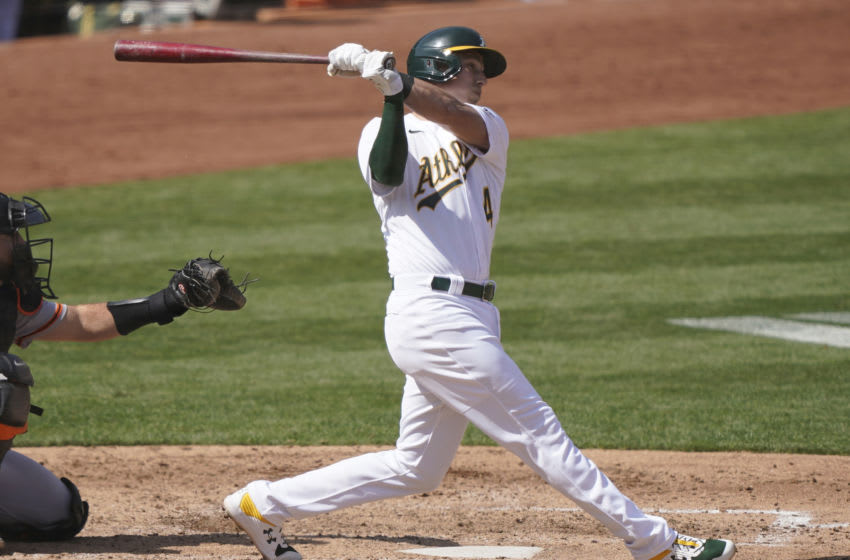 OAKLAND, CALIFORNIA - SEPTEMBER 19: Jake Lamb #4 of the Oakland Athletics bats against the San Francisco Giants in the bottom of the fifth inning at RingCentral Coliseum on September 19, 2020 in Oakland, California. (Photo by Thearon W. Henderson/Getty Images)