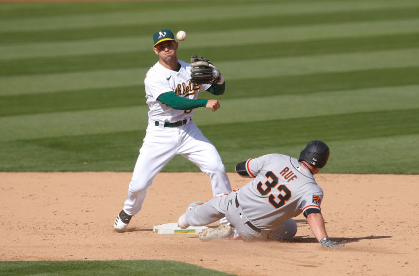 OAKLAND, CA - SEPTEMBER 19: Tommy La Stella #3 of the Oakland Athletics turns two during the game against the San Francisco Giants at RingCentral Coliseum on September 19, 2020 in Oakland, California. The Athletics defeated the Giants 6-0. (Photo by Michael Zagaris/Oakland Athletics/Getty Images)