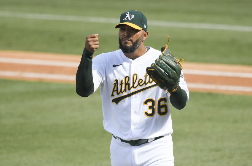 LOS ANGELES, CALIFORNIA - OCTOBER 05: Yusmeiro Petit #36 of the Oakland Athletics celebrates after retiring the side against the Houston Astros during the fifth inning in Game One of the American League Division Series at Dodger Stadium on October 05, 2020 in Los Angeles, California. (Photo by Kevork Djansezian/Getty Images)