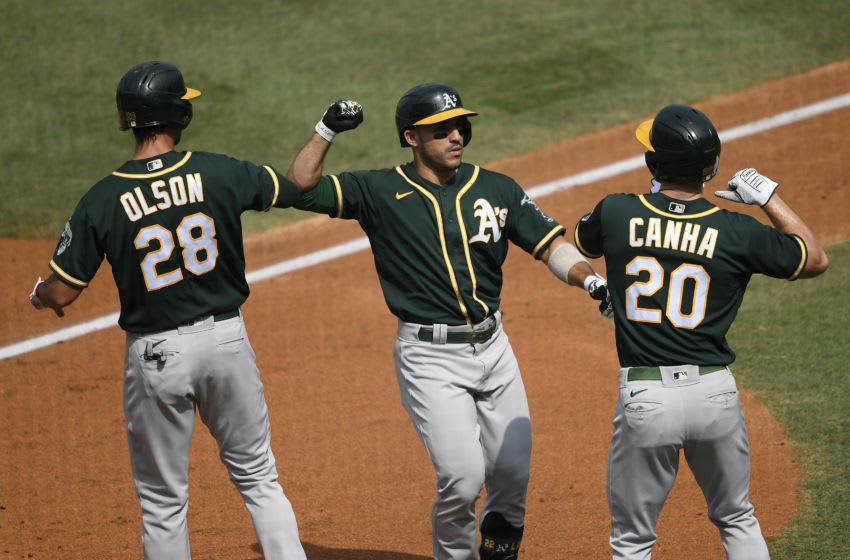 LOS ANGELES, CALIFORNIA - OCTOBER 08: Ramon Laureano #22 of the Oakland Athletics celebrates a three run home run against the Houston Astros with teammates Matt Olson #28 and Mark Canha #20 during the second inning in Game Four of the American League Division Series at Dodger Stadium on October 08, 2020 in Los Angeles, California. (Photo by Kevork Djansezian/Getty Images)