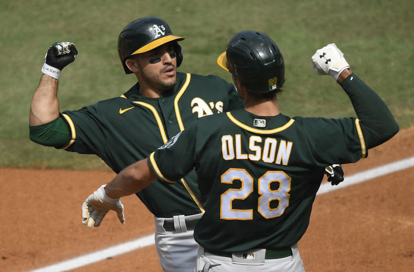 LOS ANGELES, CALIFORNIA - OCTOBER 08: Ramon Laureano #22 of the Oakland Athletics celebrates a three run home run against the Houston Astros with teammate Matt Olson #28 during the second inning in Game Four of the American League Division Series at Dodger Stadium on October 08, 2020 in Los Angeles, California. (Photo by Kevork Djansezian/Getty Images)