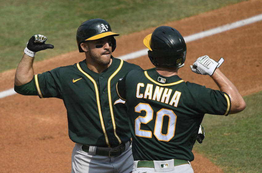 LOS ANGELES, CALIFORNIA - OCTOBER 08: Ramon Laureano #22 of the Oakland Athletics celebrates a three run home run against the Houston Astros with teammate Mark Canha #20 during the second inning in Game Four of the American League Division Series at Dodger Stadium on October 08, 2020 in Los Angeles, California. (Photo by Kevork Djansezian/Getty Images)