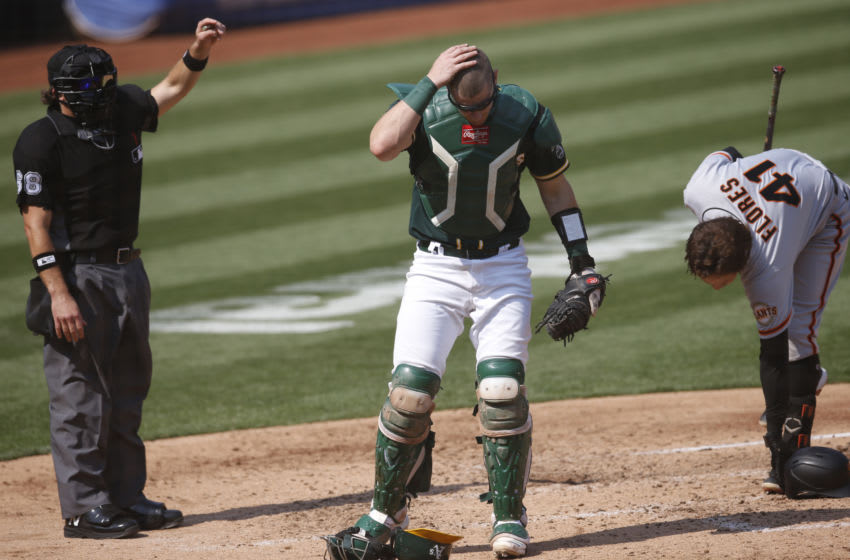 OAKLAND, CA - SEPTEMBER 20: Sean Murphy #12 of the Oakland Athletics stands at the plate after getting hit in the head by a bat during the game against the San Francisco Giants at RingCentral Coliseum on September 20, 2020 in Oakland, California. The Giants defeated the Athletics 14-2. (Photo by Michael Zagaris/Oakland Athletics/Getty Images)