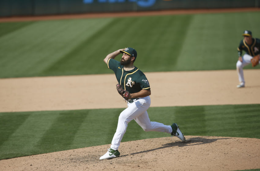 OAKLAND, CA - SEPTEMBER 20: Lou Trivino #62 of the Oakland Athletics pitches during the game against the San Francisco Giants at RingCentral Coliseum on September 20, 2020 in Oakland, California. The Giants defeated the Athletics 14-2. (Photo by Michael Zagaris/Oakland Athletics/Getty Images)