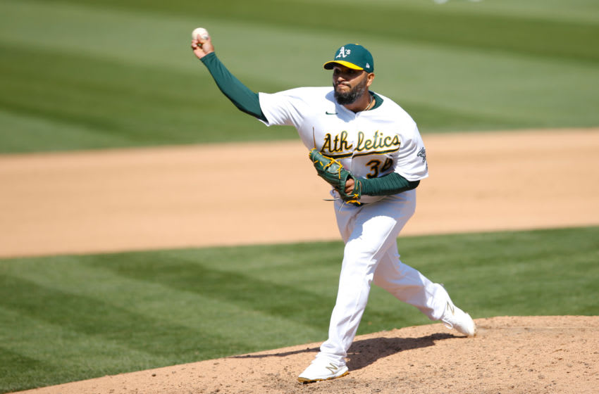 OAKLAND, CA - SEPTEMBER 29: Yusmeiro Petit #36 of the Oakland Athletics pitches during Game One of the Wild Card Round against the Chicago White Sox at RingCentral Coliseum on September 29, 2020 in Oakland, California. The White Sox defeated the Athletics 4-1. (Photo by Michael Zagaris/Oakland Athletics/Getty Images)