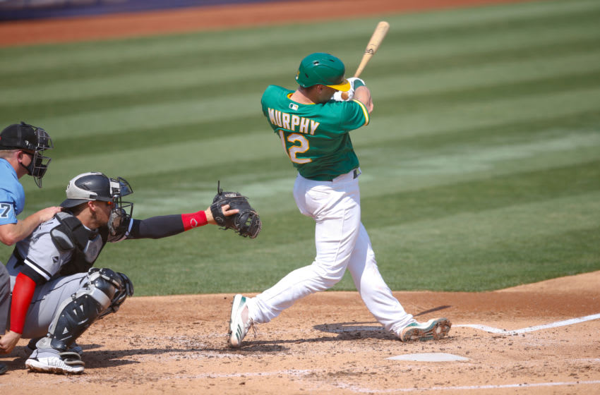 OAKLAND, CA - SEPTEMBER 30: Sean Murphy #12 of the Oakland Athletics bats during the game against the Chicago White Sox at RingCentral Coliseum on September 30, 2020 in Oakland, California. The Athletics defeated the White Sox 5-3. (Photo by Michael Zagaris/Oakland Athletics/Getty Images)