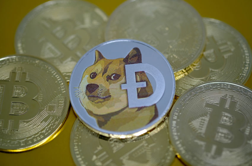 KATWIJK, NETHERLANDS - JANUARY 4: In this photo illustration, visual representations of digital cryptocurrencies, Dogecoin and Bitcoin are arranged on January 4, 2021 in Katwijk, Netherlands. (Photo by Yuriko Nakao/Getty Images)