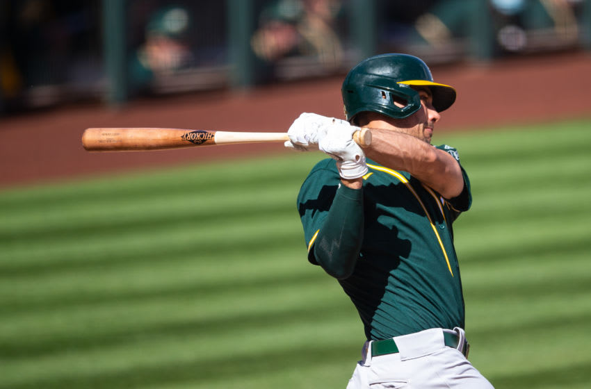 SCOTTSDALE, AZ - MARCH 03: Matt Olson #28 of the Oakland Athletics bats during a spring training game against the Colorado Rockies at Salt River Field on March 3, 2021 in Scottsdale, Arizona. (Photo by Rob Tringali/Getty Images)