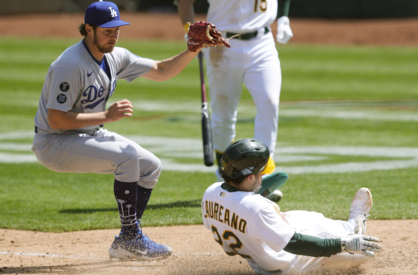 OAKLAND, CALIFORNIA - APRIL 07: Ramon Laureano #22 of the Oakland Athletics scores on a wild pitch by Trevor Bauer #27 of the Los Angeles Dodgers in the fourth inning at RingCentral Coliseum on April 07, 2021 in Oakland, California. (Photo by Thearon W. Henderson/Getty Images)