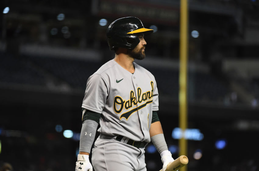 PHOENIX, ARIZONA - APRIL 13: Ka'ai Tom #1 of the Oakland Athletics walks back to the dugout after an at bat against the Arizona Diamondbacks at Chase Field on April 13, 2021 in Phoenix, Arizona. (Photo by Norm Hall/Getty Images)