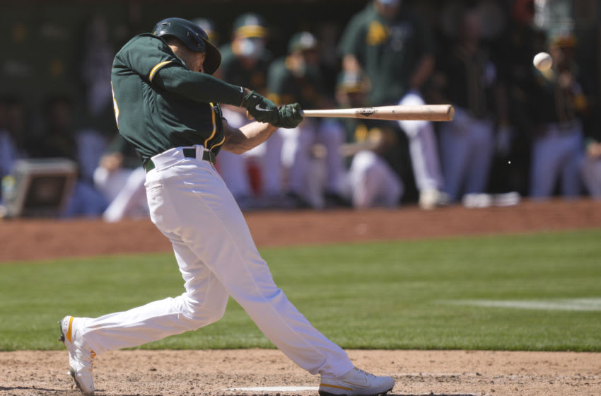 OAKLAND, CALIFORNIA - MAY 02: Matt Olson #28 of the Oakland Athletics bats against the Baltimore Orioles in the seventh inning at RingCentral Coliseum on May 02, 2021 in Oakland, California. (Photo by Thearon W. Henderson/Getty Images)