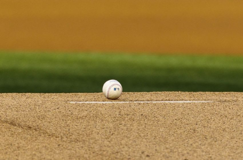 OAKLAND, CA - APRIL 07: Detailed view of a baseball on the pitchers mound before the game between the Oakland Athletics and the Seattle Mariners at O.co Coliseum on April 7, 2012 in Oakland, California. The Seattle Mariners defeated the Oakland Athletics 8-7. (Photo by Jason O. Watson/Getty Images)