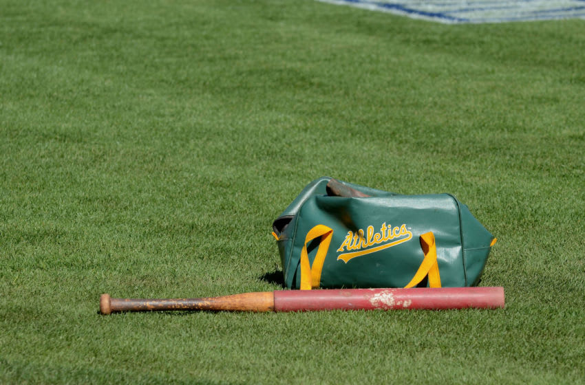 OAKLAND, CA - OCTOBER 08: A detailed view of a Oakland Athletics equipment bag and bat laying on the field during the American League Division Series Workout Day at Oakland-Alameda County Coliseum on October 8, 2012 in Oakland, California. The Detroit Tigers lead the Oakland Athletics 2 games to 0 in the ALDS. (Photo by Mark Cunningham/MLB Photos via Getty Images)