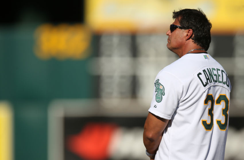 OAKLAND, CA - JULY 19: Jose Canseco #33 of the 1989 Oakland A's celebrates their World Series championship 25 years ago, before a game against the Baltimore Orioles at O.co Coliseum on July 19, 2014 in Oakland, California. (Photo by Brad Mangin/MLB Photos via Getty Images)