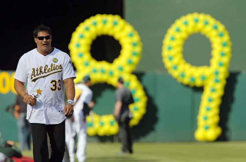OAKLAND, CA - JULY 19: Jose Canseco #33 of the 1989 Oakland A's joins his former teammates to celebrate their World Series championship of 25 years ago against the San Francisco Giants before a game at O.co Coliseum on July 19, 2014 in Oakland, California. (Photo by Brian Bahr/Getty Images)