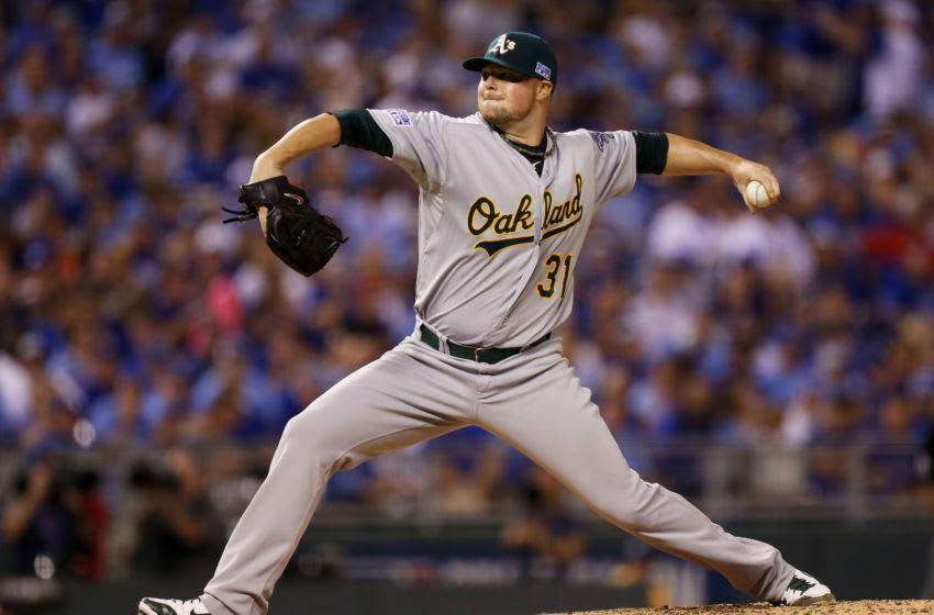 KANSAS CITY, MO - SEPTEMBER 30: Jon Lester #31 of the Oakland Athletics pitches in the second inning against the Kansas City Royals during the American League Wild Card game at Kauffman Stadium on September 30, 2014 in Kansas City, Missouri. (Photo by Ed Zurga/Getty Images)