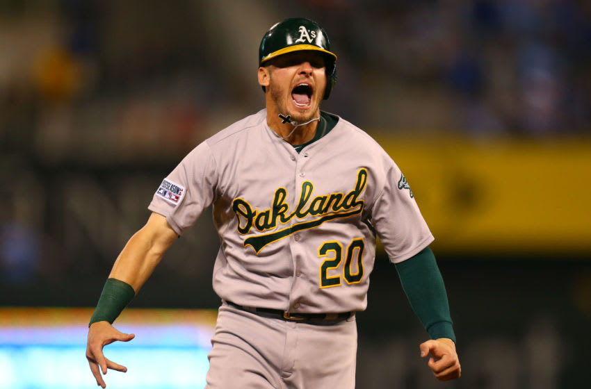 KANSAS CITY, MO - SEPTEMBER 30: Josh Donaldson #20 of the Oakland Athletics celebrates after Brandon Moss #37 of the Oakland Athletics hit a three-run home run in the sixth inning against the Kansas City Royals during the American League Wild Card game at Kauffman Stadium on September 30, 2014 in Kansas City, Missouri. (Photo by Dilip Vishwanat/Getty Images)