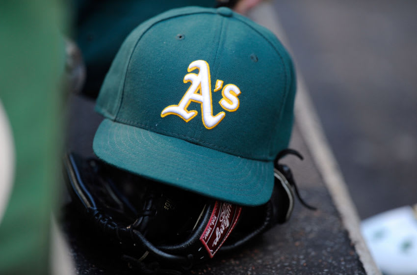 BALTIMORE, MD - AUGUST 15: An Oakland Athletics hat and glove on the steps of the dugout during the game against the Baltimore Orioles at Oriole Park at Camden Yards on August 15, 2015 in Baltimore, Maryland. (Photo by G Fiume/Getty Images)