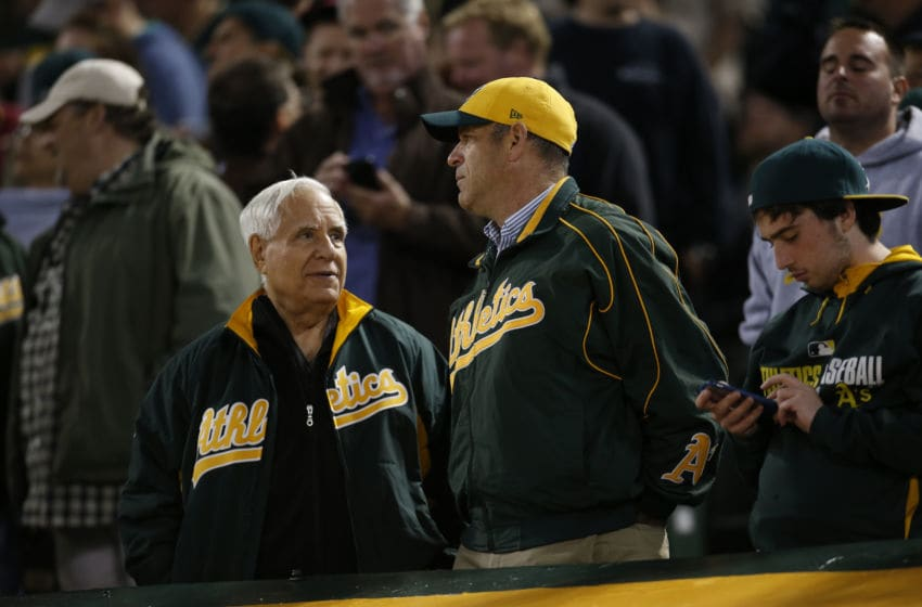 OAKLAND, CA - JULY 19: Owner Lew Wolff and Owner John Fisher of the Oakland Athletics talk in the stands during the game against the Houston Astros at the Oakland Coliseum on July 19, 2016 in Oakland, California. The Athletics defeated the Astros 4-3. (Photo by Michael Zagaris/Oakland Athletics/Getty Images)