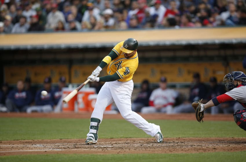 OAKLAND, CA - SEPTEMBER 3: Yonder Alonso #17 of the Oakland Athletics bats during the game against the Boston Red Sox at the Oakland Coliseum on September 3, 2016 in Oakland, California. The Red Sox defeated the Athletics 11-2. (Photo by Michael Zagaris/Oakland Athletics/Getty Images)