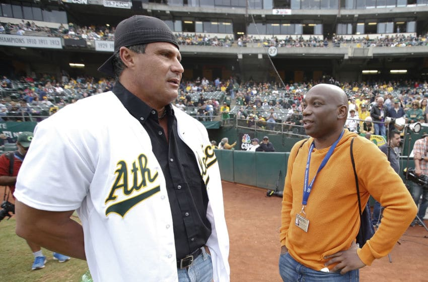 OAKLAND, CA - SEPTEMBER 3: Jose Canseco talks with Howard Bryant of ESPN on the field prior to the game between against the Oakland Athletics at the Oakland Coliseum on September 3, 2016 in Oakland, California. The Red Sox defeated the Athletics 11-2. (Photo by Michael Zagaris/Oakland Athletics/Getty Images)