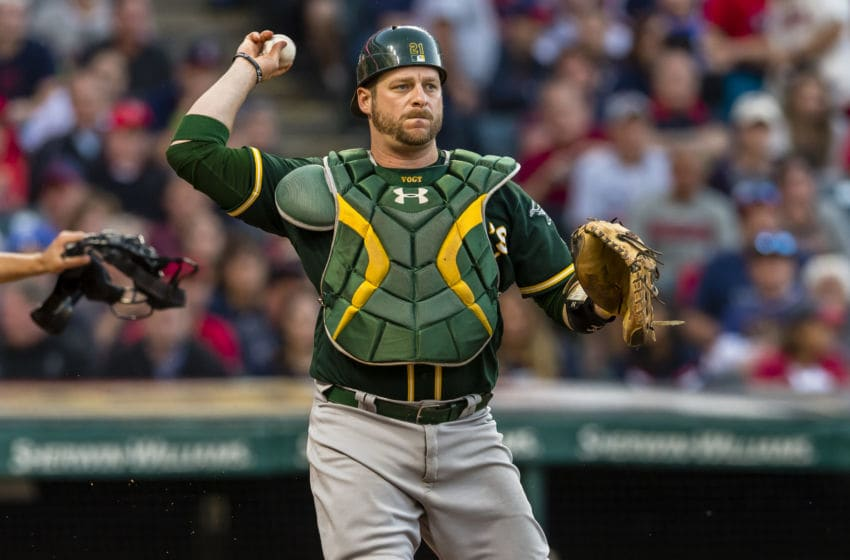 CLEVELAND, OH - MAY 31: Catch Stephen Vogt #21 of the Oakland Athletics throws out Austin Jackson #26 of the Cleveland Indians at first during the eighth inning at Progressive Field on May 31, 2017 in Cleveland, Ohio. The Athletics defeated the Indians 3-1. (Photo by Jason Miller/Getty Images)
