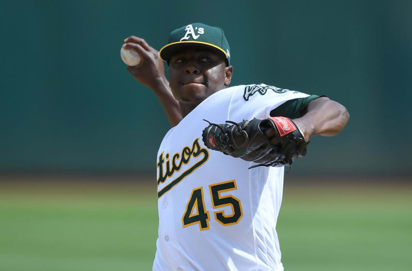 OAKLAND, CA - SEPTEMBER 24: Jharel Cotton #45 of the Oakland Athletics pitches against the Texas Rangers in the top of the first inning at Oakland Alameda Coliseum on September 24, 2017 in Oakland, California. (Photo by Thearon W. Henderson/Getty Images)
