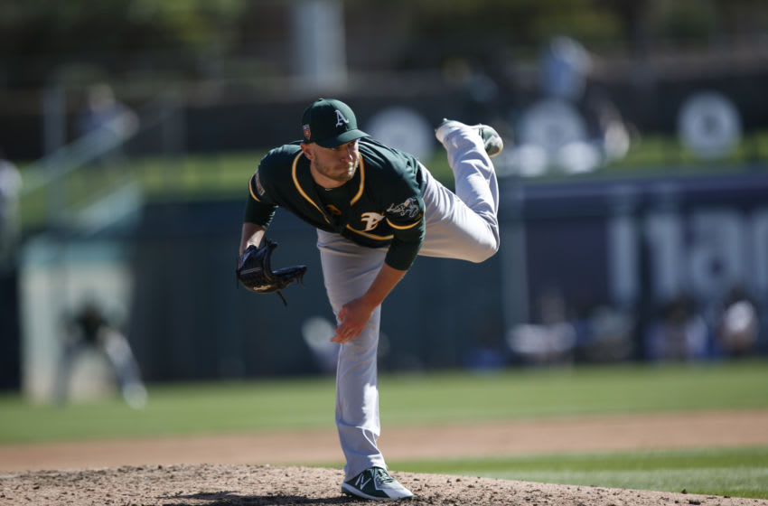 PHOENIX, AZ - FEBRUARY 26: Eric Jokisch #70 of the Oakland Athletics pitches during the game against the Chicago White Sox at Camelback Ranch on February 26, 2018 in Phoenix, Arizona. (Photo by Michael Zagaris/Oakland Athletics/Getty Images) *** Local Caption *** Eric Jokisch